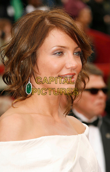 CAMERON DIAZ.The 79th Annual Academy Awards - Arrivals held at the Kodak Theatre, Hollywood, California, USA,.25 February 2007..oscars red carpet portrait headshot white off the shulder dress green dangly earrings .CAP/ADM/RE.©Russ Elliot/AdMedia/Capital Pictures.