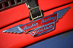 Floral Park, New York, U.S. - April 27, 2014 - A red 1960 Austin Healey 3000 MkIII, with detail of emblem and leather buckle shown, is exhibited at the 35th Annual Antique Auto Show at Queens Farm.