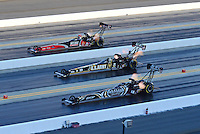 Apr. 13, 2012; Concord, NC, USA: NHRA top fuel dragster drivers Shawn Langdon (near), Tony Schumacher (center) and David Grubnic race during qualifying for the Four Wide Nationals at zMax Dragway. Mandatory Credit: Mark J. Rebilas-