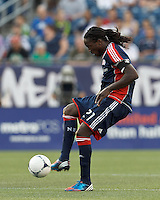 New England Revolution midfielder Shalrie Joseph (21) passes the ball. In a Major League Soccer (MLS) match, the New England Revolution tied the Seattle Sounders FC, 2-2, at Gillette Stadium on June 30, 2012.