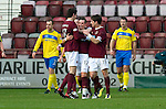 Hearts v St Johnstone...05.02.12.. Scottish Cup 5th Round.David Templeton celebrates his goal with Rudi Skacel and Ryan McGowan.Picture by Graeme Hart..Copyright Perthshire Picture Agency.Tel: 01738 623350  Mobile: 07990 594431