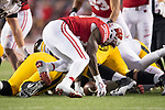 Wisconsin Badgers linebacker Leon Jacobs (32) scoops up a loose ball and returns it for a touchdown during an NCAA College Big Ten Conference football game against the Iowa Hawkeyes Saturday, November 11, 2017, in Madison, Wis. The Badgers won 38-14. (Photo by David Stluka)