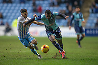Myles Weston of Wycombe Wanderers holds off Dion Kelly-Evans of Coventry City during the The Checkatrade Trophy - EFL Trophy Semi Final match between Coventry City and Wycombe Wanderers at the Ricoh Arena, Coventry, England on 7 February 2017. Photo by Andy Rowland.