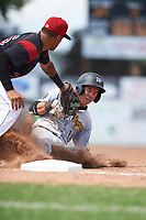 West Virginia Black Bears shortstop Andrew Walker (13) is tagged out while sliding into third base base Rony Cabrera (26) during a game against the Batavia Muckdogs on June 25, 2017 at Dwyer Stadium in Batavia, New York.  West Virginia defeated Batavia 6-4 in the completion of the game started on June 24th.  (Mike Janes/Four Seam Images)