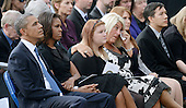 United States President Barack Obama, first lady Michelle Obama, and families of the victims get emotional at a memorial for the victims of the Washington Navy Yard shooting at the Marine Barracks, September 22, 2013 in Washington, D.C.  The President and first lady also visited with families of the victims. <br /> Credit: Olivier Douliery / Pool via CNP
