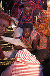 A sacrificial cow is suffocated to death at the beginning of the an initiation ceremony that will bring the young Maasai Moran (young warriors) into manhood.  Kajiado, Kenya.  The  neck is slit and blood  is drunk fresh after the animal has died.