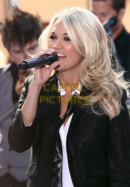"""CARRIE UNDERWOOD.performs live on the NBC's """"TODAY"""" Show live from Rockefeller Center, New York, NY, USA, 30th July 2010..music country live on stage concert gig.half length black jacket blazer white shirt tie singing microphone .CAP/ADM/PZ.©Paul Zimmerman/AdMedia/Capital Pictures."""