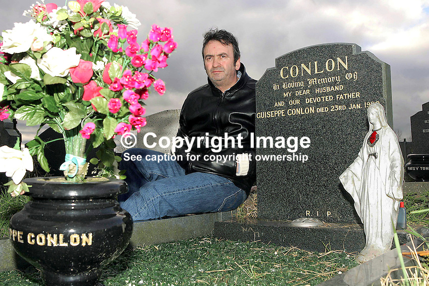 Gerard Conlon, one of the Guildford Four, pictured at the grave of his father, Guiseppe Conlon, in Milltown Cemetery, Belfast,  N Ireland, 30th January 2005. Gerard himself was to die less than 10 years later in June 2014 following an illness.  Giuseppe Conlon died in Wormwood Scrubs prison on 23rd January 1980, the same day that the UK Home Secretary, William Whitelaw, had decided to grant him parole. He had been jailed for the alleged possession of explosives. The trial of all the defendents was highlighted in the 1993 Oscar-nominated film In The Name Of The Father, starring Daniel Day-Lewis. 200501300001<br />