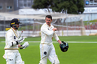 Devon Conway (left) and Malcolm Nofal walks off as rain stops play on day two of the Plunket Shield cricket match between Wellington Firebirds and Otago Volts at the Basin Reserve in Wellington, New Zealand on Thursday, 18 October 2018. Photo: Dave Lintott / lintottphoto.co.nz
