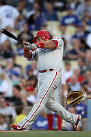 Carlos Ruiz #51 of the Philadelphia Phillies bats against the Los Angeles Dodgers at Dodger Stadium on July 16, 2012 in Los Angeles, California. Philadelphia defeated Los Angeles 3-2. (Larry Goren/Four Seam Images)