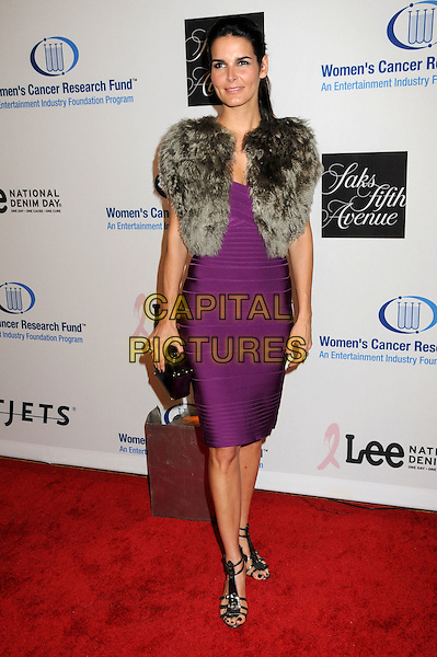 ANGIE HARMON .EIF's Women's Cancer Research Fund Benefit held at the Beverly Wilshire Hotel, Beverly Hills, California, USA..January 27th, 2010.full length purple dress grey gray beige fur wrap jacket gilet clutch bag black sandals shoes .CAP/ADM/BP.©Byron Purvis/AdMedia/Capital Pictures.