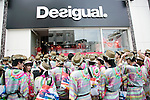 "Tokyo, Japan - Customers wait outside the Desigual store during the grand opening in Tokyo's Harajuku fashion district. A fashion chain called ""Seminaked Party by Desigual"" offers the first 100 customers (wearing swimsuit) free clothing items at the grand opening in Tokyo, Japan, June 22, 2013. More than 4,000 people attend the Seminaked Party around the world. (Photo by Rodrigo Reyes Marin/AFLO)"
