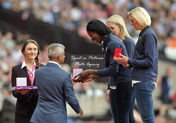 Christine Ohuruogu recieves her Bronze medal for the IAAF world championships in Berlin 2009 from Mayor of London Sadiq Khan. IAAF World athletics championships. London Olympic stadium. Queen Elizabeth Olympic park. Stratford. London. UK. 04/08/2017. ~ MANDATORY CREDIT Garry Bowden/SIPPA - NO UNAUTHORISED USE - +44 7837 394578