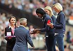 Christine Ohuruogu recieves her Bronze medal for the IAAF world championships in Berlin 2009 from Mayor of London Sadiq Khan. IAAF World athletics championships. London Olympic stadium. Queen Elizabeth Olympic park. Stratford. London. UK. 04/08/2017. ~ MANDATORY CREDIT Garry Bowden/SIPPA - NO UNAUTHORISED USE - +44 7837 394578