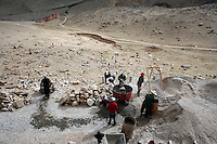 China started building a controversial 67-mile &quot;paved highway fenced with undulating guardrails&quot; to Mount Qomolangma, known in the west as Mount Everest, to help facilitate next year's Olympic Games torch relay./// Trucks and workers building the road to Everest Base Camp. <br /> Tibet, China<br /> July, 2007