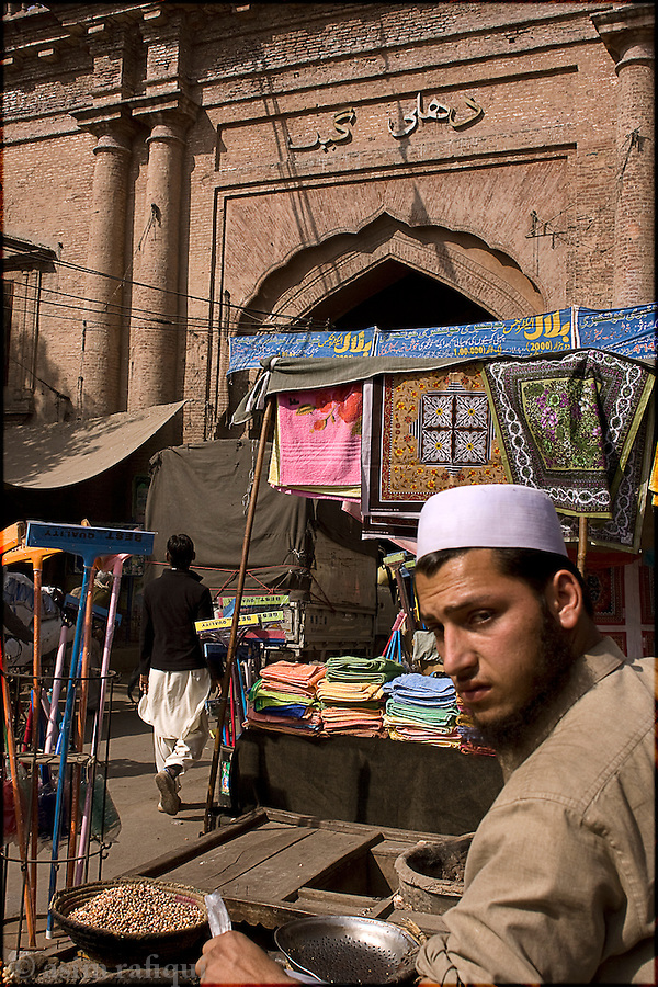 at the entrance of the famous delhi gate, one of 12 gates that offers entrance into the old city of Lahore