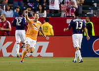Houston Dynamo midfielder Brad Davis (11) begins to celebrate after scoring a goal. The Houston Dynamo defeated CD Chivas USA 2-0 at Home Depot Center stadium in Carson, California on Saturday May 8, 2010.  .
