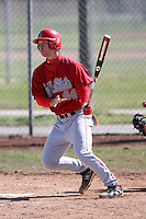 April 5, 2009:  Outfielder Nathan Koontz (44) of the Ball State Cardinals hits a home run to left field in the bottom of the third inning during a game at Amherst Audubon Field in Buffalo, NY.  Photo by:  Mike Janes/Four Seam Images