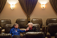 Matile Rothschild, left, and Joan Zimmerman hold hands as they sit in the movie theater of the Fountaingrove Lodge, the country's first LGBT retirement community with the option of continuing care services, where they reside in Santa Rosa, Calif., on December 30, 2013. (Alvin Jornada / Special to The Chronicle)