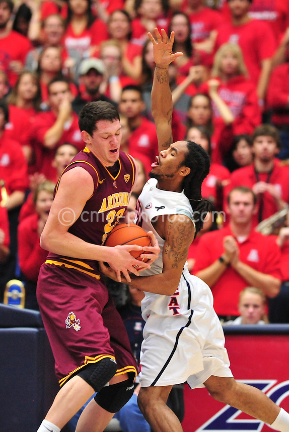 Jan 15, 2011; Tucson, AZ, USA; Arizona State Sun Devils center Ruslan Pateev (23) steals the ball from Arizona Wildcats forward Jesse Perry (33) in the 1st half of a game at the McKale Center.