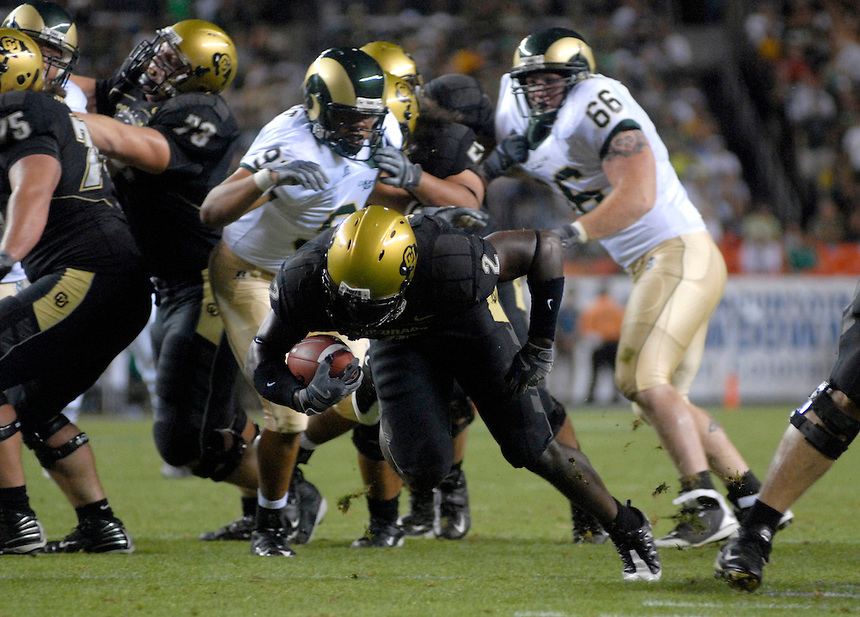 31 Aug 2008: Colorado running back Darrell Scott (2) advances the ball against Colorado State. The Colorado Buffaloes defeated the Colorado State Rams 38-17 at Invesco Field at Mile High in Denver, Colorado. FOR EDITORIAL USE ONLY