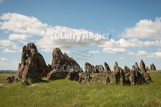 Metamorphic tombstone rocks, clouds. Spring time in the Sierra Nevada foothills of central California.