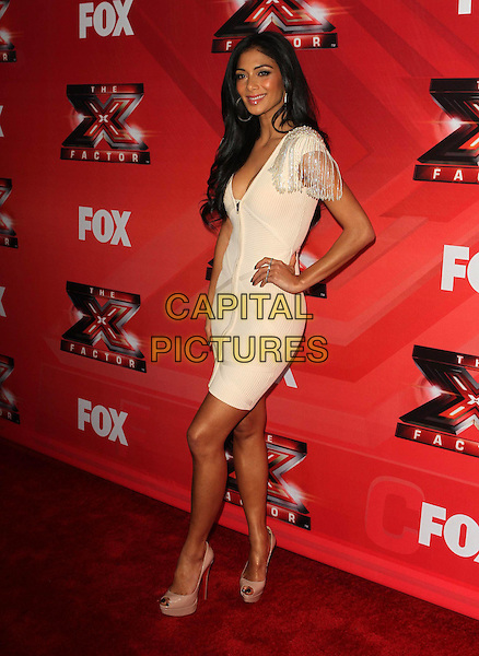 """Nicole Scherzinger.FOX's """"The X Factor"""" Press Conference held at CBS Television City, Los Angeles, California, USA..December 19th, 2011.full length white cream dress cleavage low cut neckline zip zipper beads beaded shoulders hand on hip side .CAP/ADM/KB.©Kevan Brooks/AdMedia/Capital Pictures."""