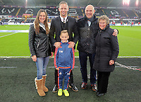 Lee Trundle with youth academy player during the Barclays Premier League match between Swansea City and Leicester City at the Liberty Stadium, Swansea on December 05 2015