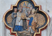 The reception of St John's head in Amiens, plaque on the North side of the Gothic choir screen, 1490-1530, commissioned by canon Adrien de Henencourt and made by the sculptor Antoine Ancquier, depicting the life of St John the Baptist, at the Basilique Cathedrale Notre-Dame d'Amiens or Cathedral Basilica of Our Lady of Amiens, built 1220-70 in Gothic style, Amiens, Picardy, France. Amiens Cathedral was listed as a UNESCO World Heritage Site in 1981. Picture by Manuel Cohen