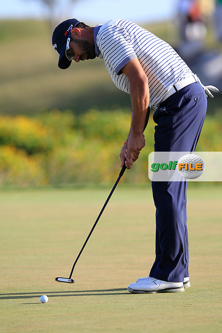 Alvaro Quiros (ESP) putts on the 18th green during Saturday's Round 3 of the 2013 Portugal Masters held at the Oceanico Victoria Golf Club. 12th October 2013.<br />