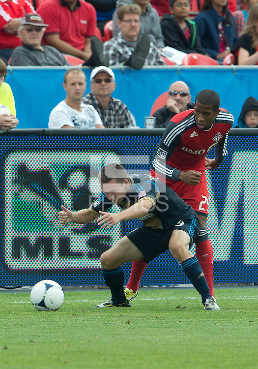 15 September 2012: Philadelphia Union forward Jack McInerney #9 and Toronto FC defender Jeremy Hall #25 in action during an MLS game between the Philadelphia Union and Toronto FC at BMO Field in Toronto, Ontario Canada. .