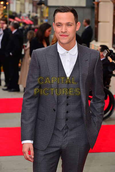 Will Young.The Laurence Olivier Awards 2013 at The Royal Opera House, London, England. .April 28, 2013.half length grey gray suit waistcoat hand in pocket.CAP/BF.©Bob Fidgeon/Capital Pictures