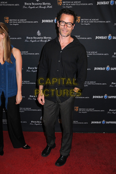 GUY PEARCE .17th Annual BAFTA Los Angeles Awards Season Tea Party held at the Four Seasons Hotel, Beverly Hills, California, USA, 15th January 2011..full length  shirt  black  hand in pocket .CAP/ADM/BP.©Byron Purvis/AdMedia/Capital Pictures.