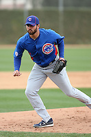 Trey McNutt #71 of the Chicago Cubs participates in pitchers fielding practice during spring training workouts at the Cubs complex on February 19, 2011  in Mesa, Arizona. .Photo by Bill Mitchell / Four Seam Images.