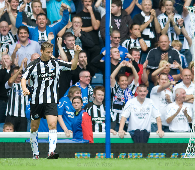 Peter Lovenkrands celebrates his goal after coming on as a sub for Newcastle Utd