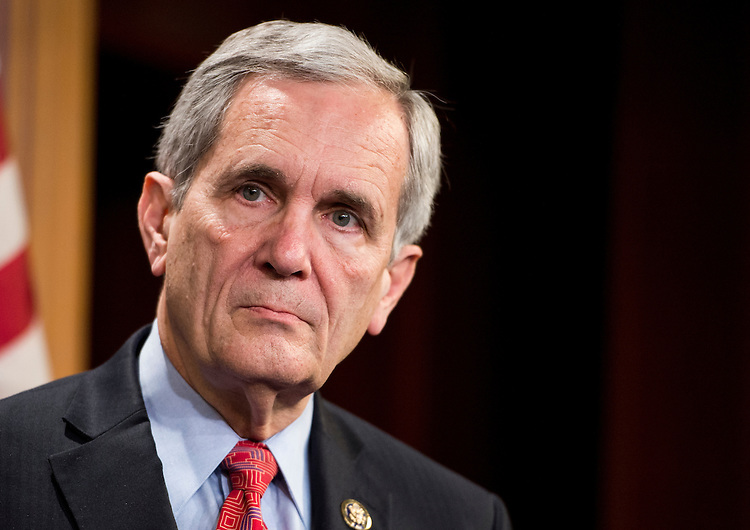 "UNITED STATES - JANUARY 20: Rep. Lloyd Doggett, D-Texas, listens as other members speak during the press conference on Tuesday, Jan. 20, 2015, to announce legislation ""to tighten restrictions on corporate tax inversions."" (Photo By Bill Clark/CQ Roll Call)"