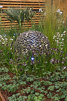 Garden illumination on pretty deck and privacy fencing, gazing ball