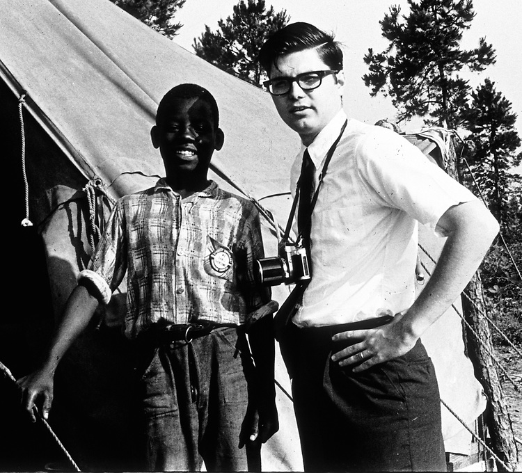 One of the Scott children with Courier Photographer, Jim Peppler, photographed at Tent City in Lowndes County, Alabama. (Photographer Unknown)