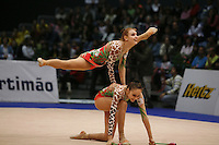 Katerina Pisetsky and Israeli rhythmic group performs hoops+clubs routine at 2008 Portimao World Cup of Rhythmic Gymnastics on April 20, 2008.  Photo by Tom Theobald.