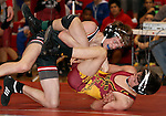 SIOUX FALLS, SD - DECEMBER 28:  Jacob Puppe from Brookings rolls over Brandon Carroll from Roosevelt in their 106 pound championship match Saturday afternoon December 28, 2013 at Lincoln High School in Sioux Falls, South Dakota. (Photo by  Dave Eggen/Inertia)