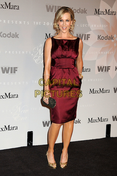 JULIE BENZ.2010 Women In Film Crystal+Lucy Awards held at the Hyatt Regency Century Plaza Hotel, Century City, California, USA..June 1st, 2010.full length dress hand on hip in pocket gold shoes red burgundy maroon silk satin sleeveless clutch bag .CAP/ADM/BP.©Byron Purvis/AdMedia/Capital Pictures.