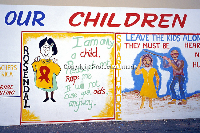 disiabu00011.Social Issues. Abuse. A painting on a wall telling an anti- message about rape and abuse of children on February 28, 2002 in Upington in northern province in South Africa. The country has a big problem with child abuse and sexual abuse of children. An 8-month old baby called Baby Thsepang was raped in Louisevale, a poor township outside Upington. The rape case made nationa and international news..©Per-Anders Pettersson/ iAfrika Photos
