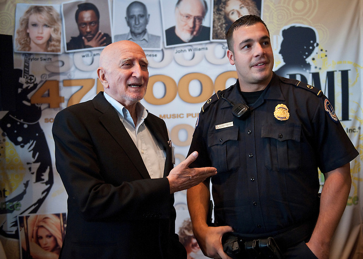UNITED STATES - SEPTEMBER 22: Sopranos actor Dominic Chianese, aka Uncle Junior,  talks with U.S. Capitol Police officer Rosario Smirne during the Fourth Annual Copyright Alliance Exponential in the Dirksen Senate Office building on Wednesday, Sept. 22, 2010. (Photo By Bill Clark/Roll Call via Getty Images)