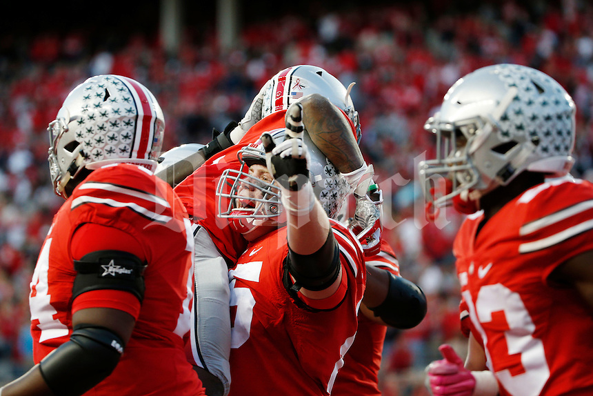 Ohio State Buckeyes offensive lineman Pat Elflein (65) hoists up teammate Ohio State Buckeyes wide receiver Dontre Wilson (2) after Wilson scored during the fourth quarter of a NCAA Division I college football game between the Ohio State Buckeyes and the Indiana Hoosiers on Saturday, October 8, 2016 at Ohio Stadium in Columbus, Ohio. (Joshua A. Bickel/The Columbus Dispatch)