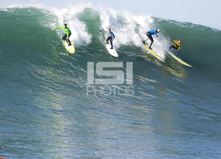 "From left to right, Anthony Tashnick, Evan Slater, Tyler Smith, and Grant ""Twiggy"" Baker, surf during the semi final heat of the 2008 Mavericks Surf Contest in Half Moon Bay, Calif., Saturday, January 12, 2008."
