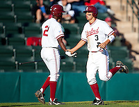 STANFORD, CA - March 29, 2011: Brian Ragira and Kenny Diekroeger of Stanford baseball high-five after Diekroeger scored during Stanford's game against St. Mary's at Sunken Diamond. Stanford won 16-14.