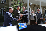 Lt. Gov. Brian Krolicki, left, watches as Gov. Brian Sandoval and Luke Russell, with Nevada mining company Coeur Rochester, lift a 60-pound silver bar during a press conference Wednesday, May 1, 2013, at the Capitol in Carson City, Nev. Coeur Rochester donated the silver to be minted into 1,000 commemorative coins for the upcoming Sesquicentennial celebration. Coin-maker Ken Hopple and Bob Nylan, with the Nevada State Museum, are at right. .Photo by Cathleen Allison