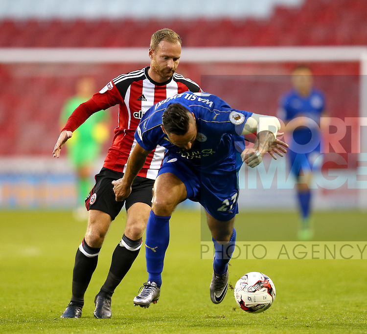 Matt Done of Sheffield Utd tussles Marcin Wasilewski of Leicester City U23 during the Checkatrade Trophy match at Bramall Lane Stadium, Sheffield. Picture date: August 30th, 2016. Pic Simon Bellis/Sportimage