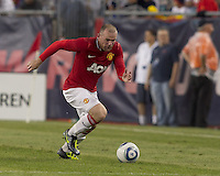 Manchester United FC forward Wayne Rooney (10) on the attack. In a Herbalife World Football Challenge 2011 friendly match, Manchester United FC defeated the New England Revolution, 4-1, at Gillette Stadium on July 13, 2011.