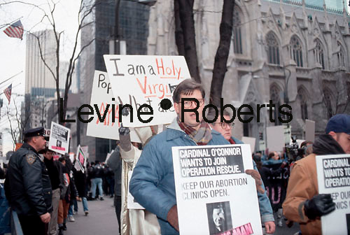 Hundreds of members of ACT UP including future City Councilmember and State Senator Tom Duane (C), demonstrate in front of St. Patrick's Cathedral on December 10, 1989. The activists were protesting the churches (and specifically Cardinal O'Connor's) stand on abortion and gay rights. During the Sunday demo the service in the cathedral was disrupted. (© Frances M. Roberts)